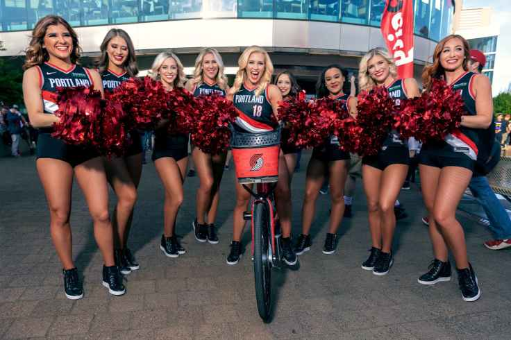 portland trail blazers cheerleaders holding maroon pompoms